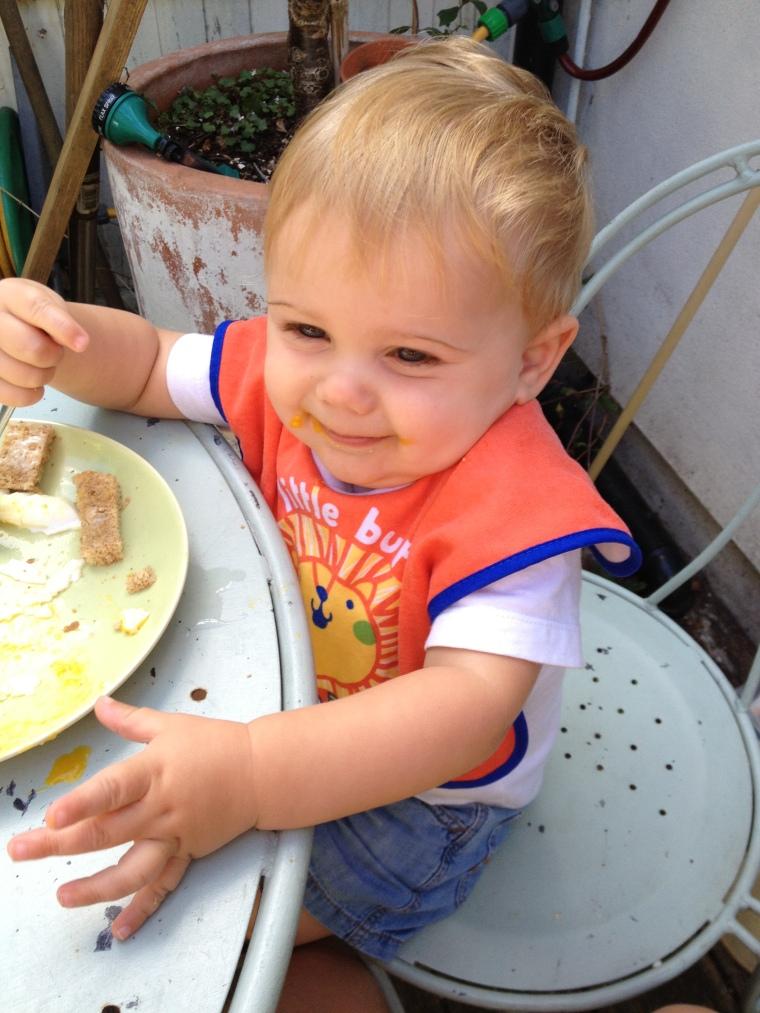 Young Dylan enjoying a runny golden yolk